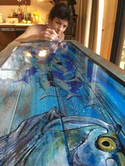 Kathleen Mazzotta paints tarpon table